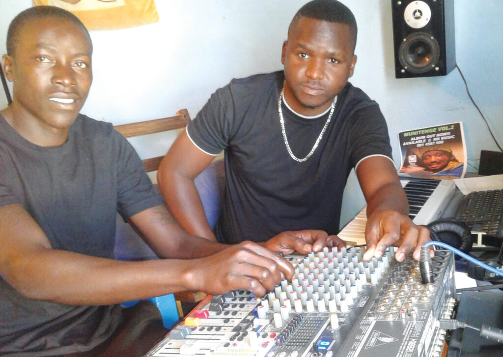 Mr.Linus Buchane(Right) the owner and founding producer of Heaven Music Studios with assistant producer Mr.Davis Kamwi (Left)